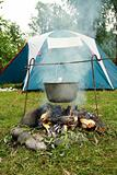 tent and saucepan on a fire