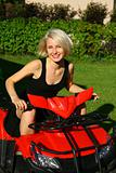 Portrait of a beautiful young lady on the all-terrain vehicle (A