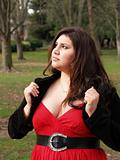 Large young woman in red dress outdoors