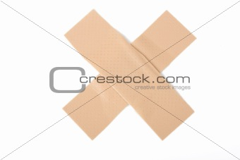 a cross of bandaids on white background