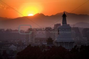 Beihai Stupa with Sunset and Mountains Beijing China