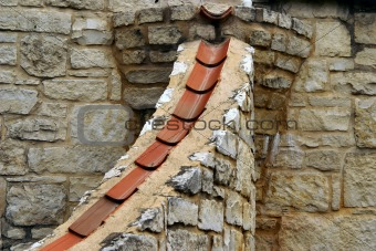 Tile and limestone form a downspout