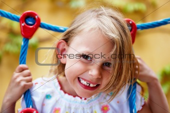 Portrait of a happy little girl having fun
