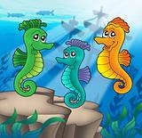 Sea horses family with shipwreck