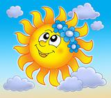 Smiling Sun with flowers on blue sky