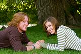 Young couple holding hands in the Park