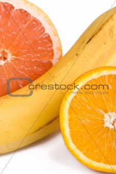 Orange, grapefruit and banana close up