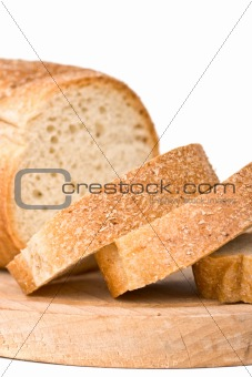 Sliced bread on wooden plate