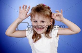 little girl make faces