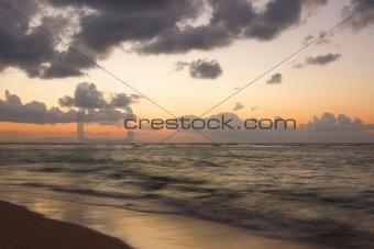 Calm ocean and beach on tropical sunrise