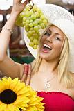 Eating Grapes In The Market