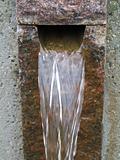running water through stone