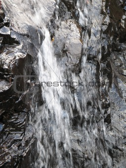 waterfall on a rock