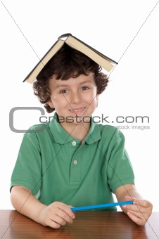 adorable boy reading a book