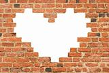 Heart shaped hole in  brick wall