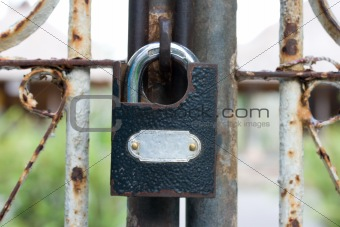 Old closed padlock on gate