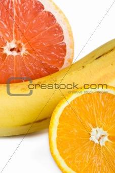 Orange, grapefruit and banana close up