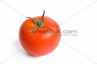 Single red tomato isolated on white