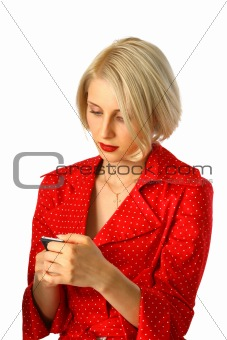 beautiful young woman reading message by phone