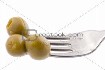 Green olive on fork