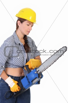 Beauty woman with chainsaw