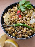 Bowl of Green Lentils cooked with Sliced Lemon Chili and Coriand