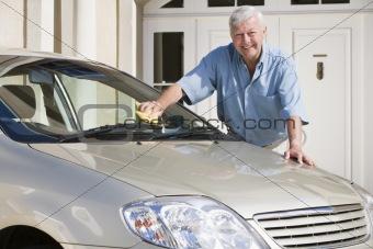 Senior man cleaning car