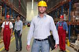 boss at the front of team of workforce in warehouse
