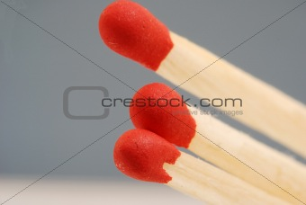 Close up of three red wooden matches