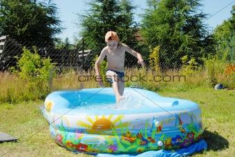 Boy in swimming pool.