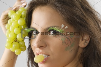 grape between lips