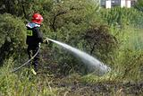 Fireman fighting a heath fire in Gdansk, Poland