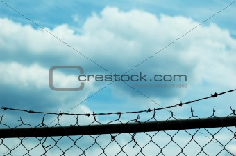 Chain link fence and sky