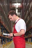 worker with bar code reader in warehouse