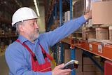 senior worker with bar code reader in warehouse
