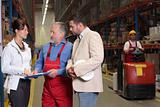 managers and senior supervisor meeting in warehouse
