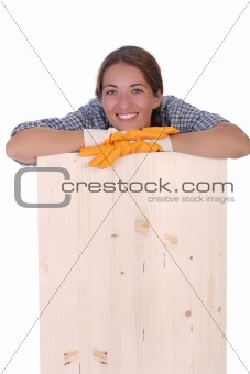 woman carpenter holding wooden plank