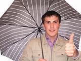Young man under a umbrella