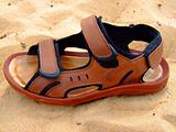Summer open footwear on sand.