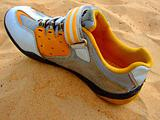 Sports boot on sand.