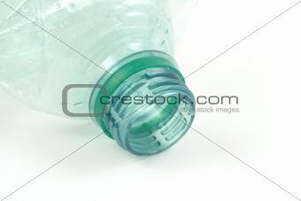 green plastic bottle isolated on white in studio