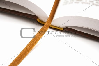 opened book with golden bookmark isolated