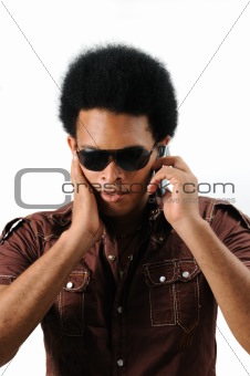 Latino man using cell phone