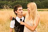 Young couple in the meadow in summer