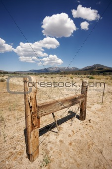 Aged Fence and Clouds