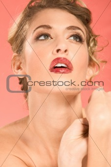 Portrait of beautiful blonde wearing dramatic make up