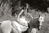 Young woman riding on horse (motion blur)