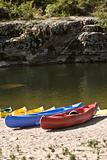 touring canoes on river bank
