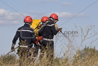 firemen putting out bush fire