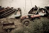 vintage tractor and traditional fishing boats